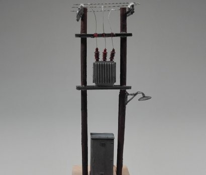 Wooden power pole miniature in HO scale with led light, ready to be installed to your diorama.